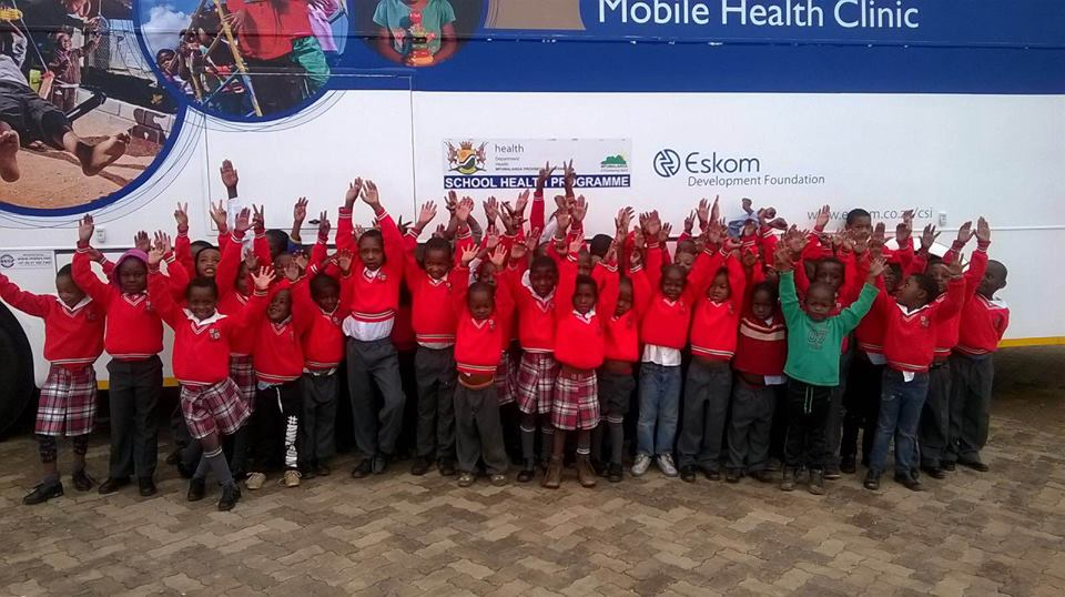 Kids in front of the Eskom Mobile Clinic